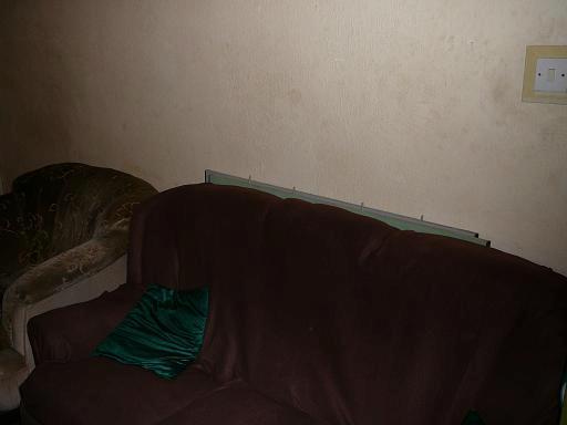 Tucked Away behind sofa! :)