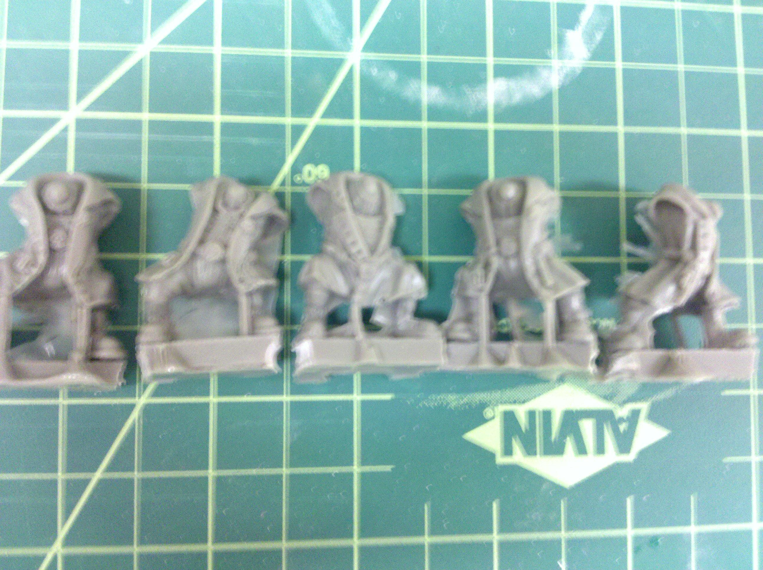 3rd Pack: Ork bodys with heavy armor in trenchcoats from micro art studios