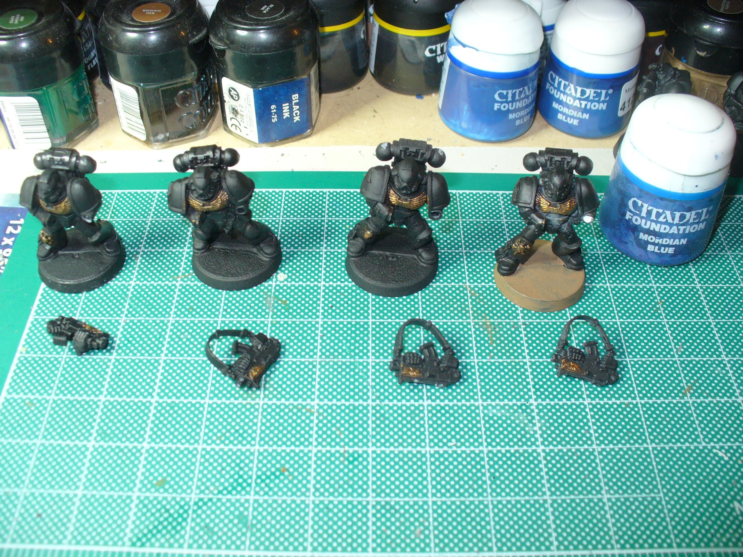 Bolter-armed Space Marines, everything gets undercoated black, these guys have Shining Gold dry brushed onto their chest eagles and a few other details