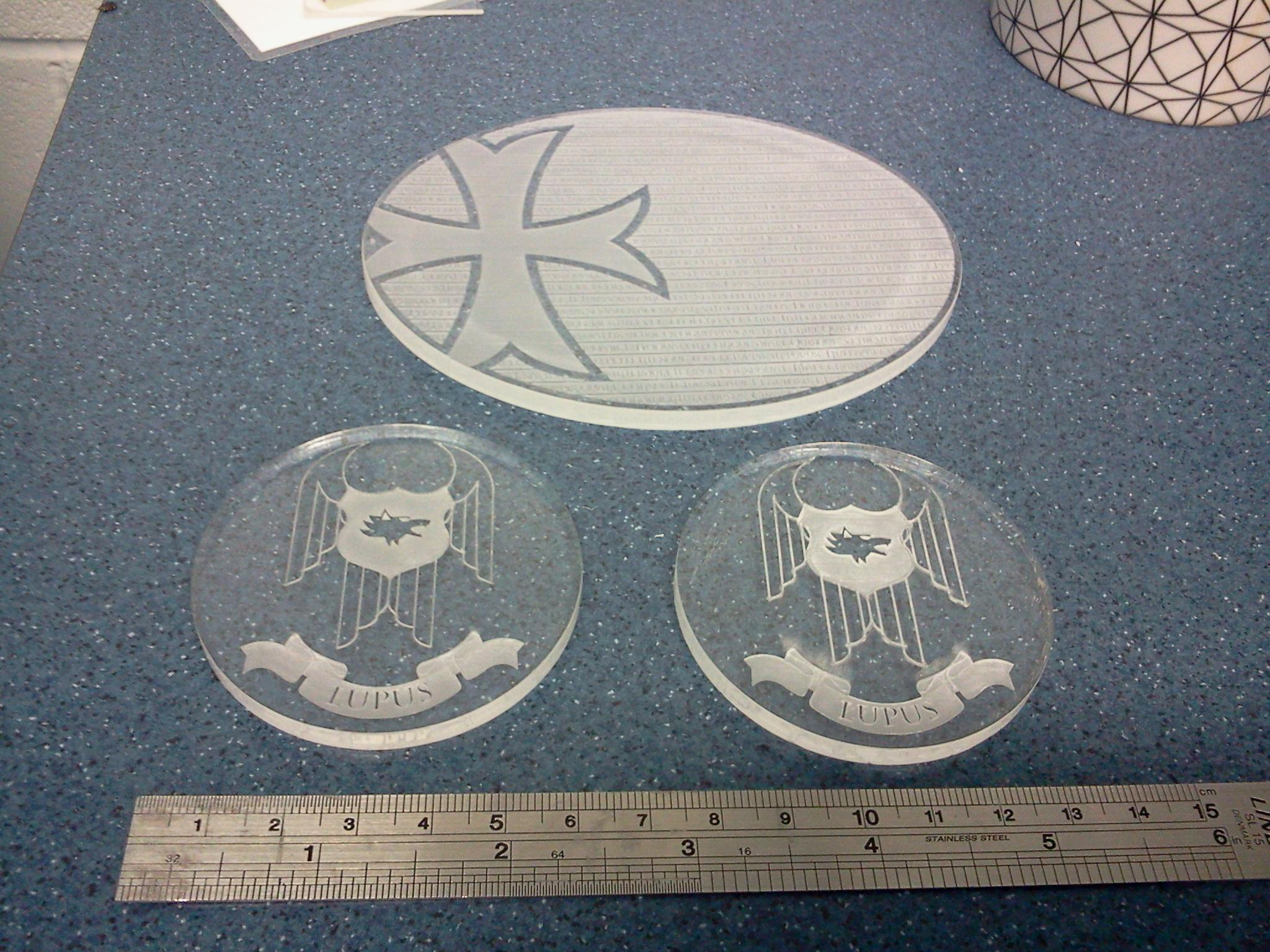 Some laser engraved 60mm bases and a flying base. The flying base has loads of writing on it