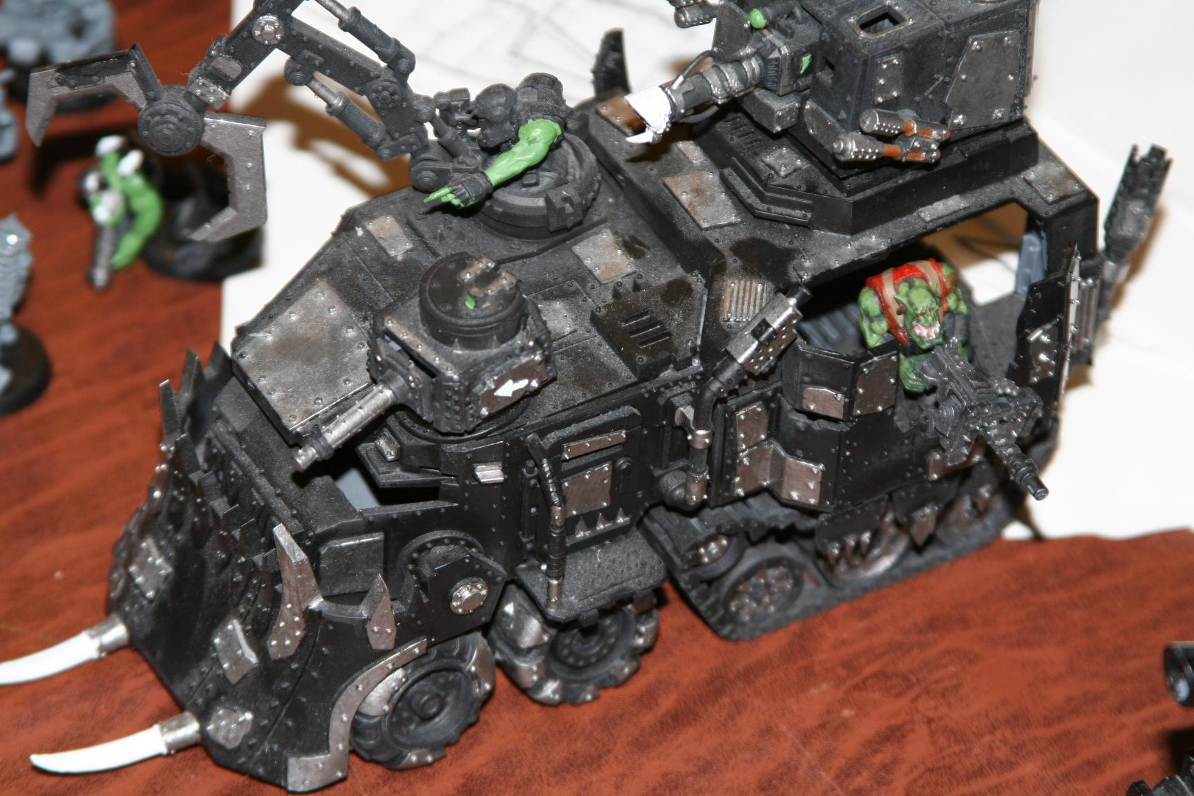 My friend's (former) Battlewagon.  I painted that gunner on the side