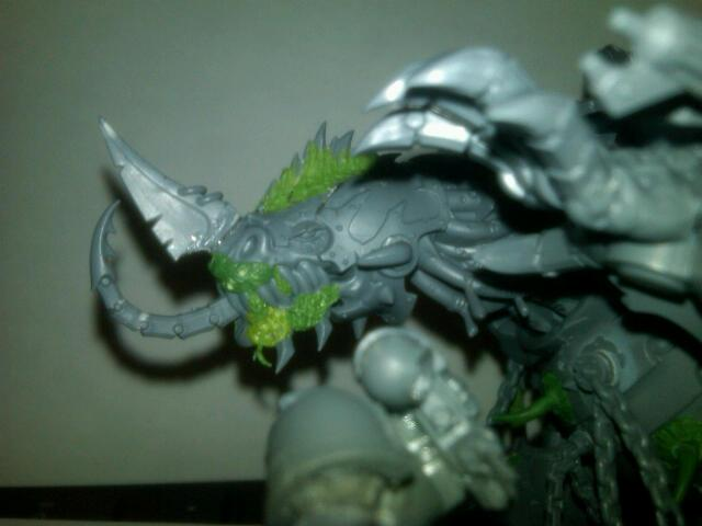 Better facial pic. Notice the spines on the head instead of the small spikes. They are the backs of the BloodCrusher riders. And the horn is from a Bloodcrusher and I just cut it down