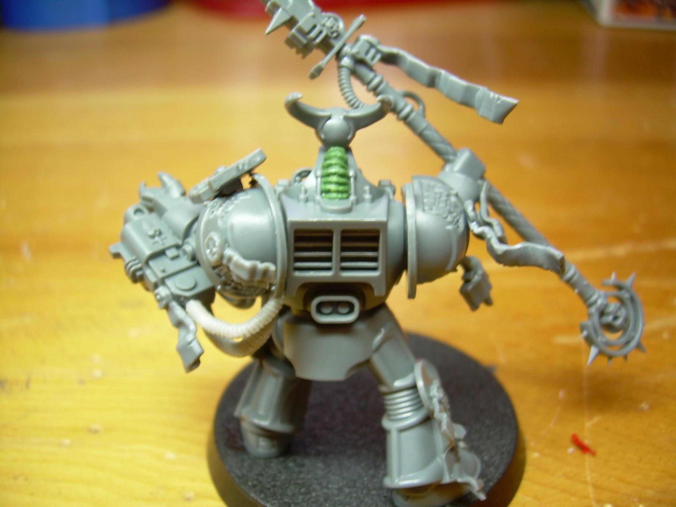 skull from the GK sprue and a green stuff spine for his hood