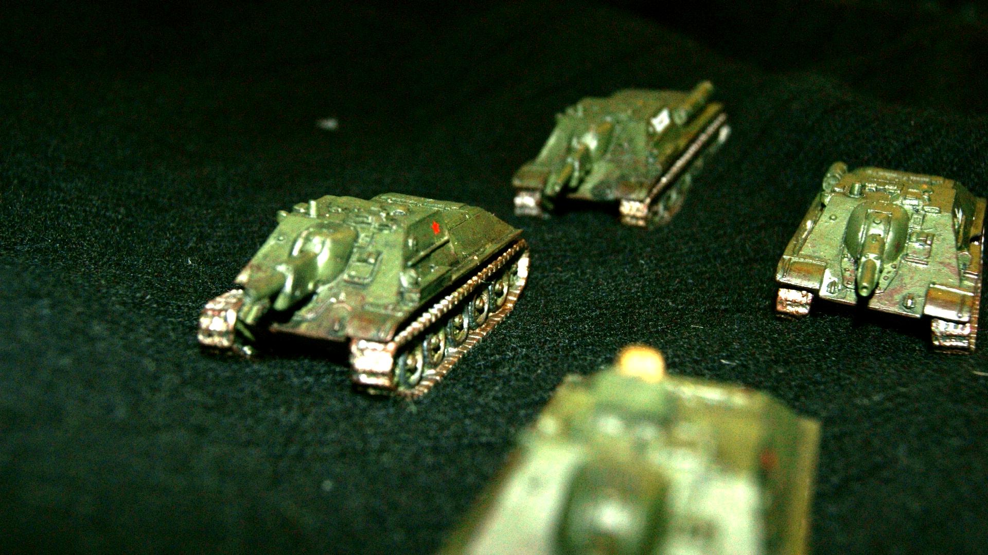 4 SU-122's rolling across a cashmere field