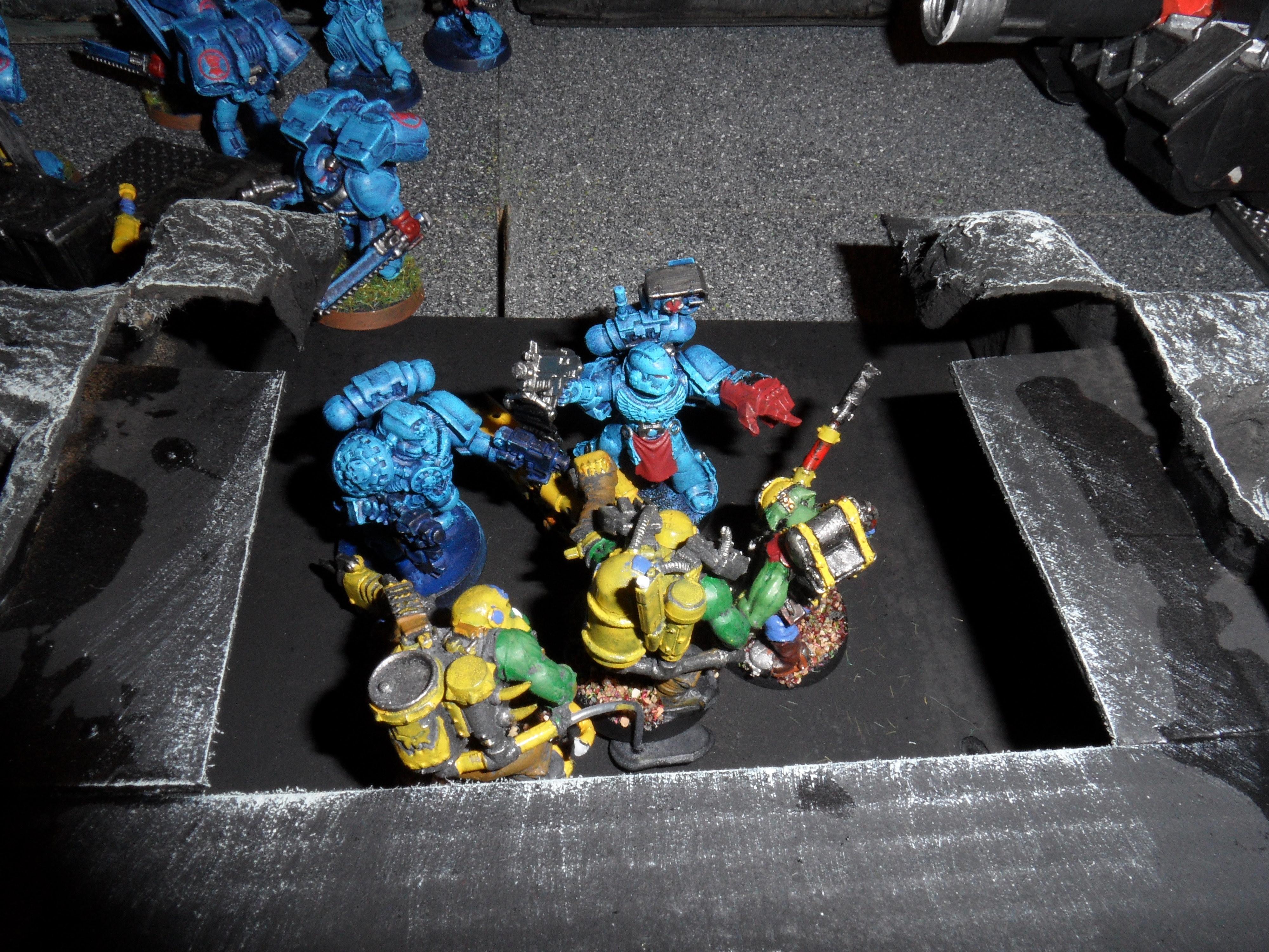 The Devastator Sgt and the Tech Marine wipe out the Burna Boyz
