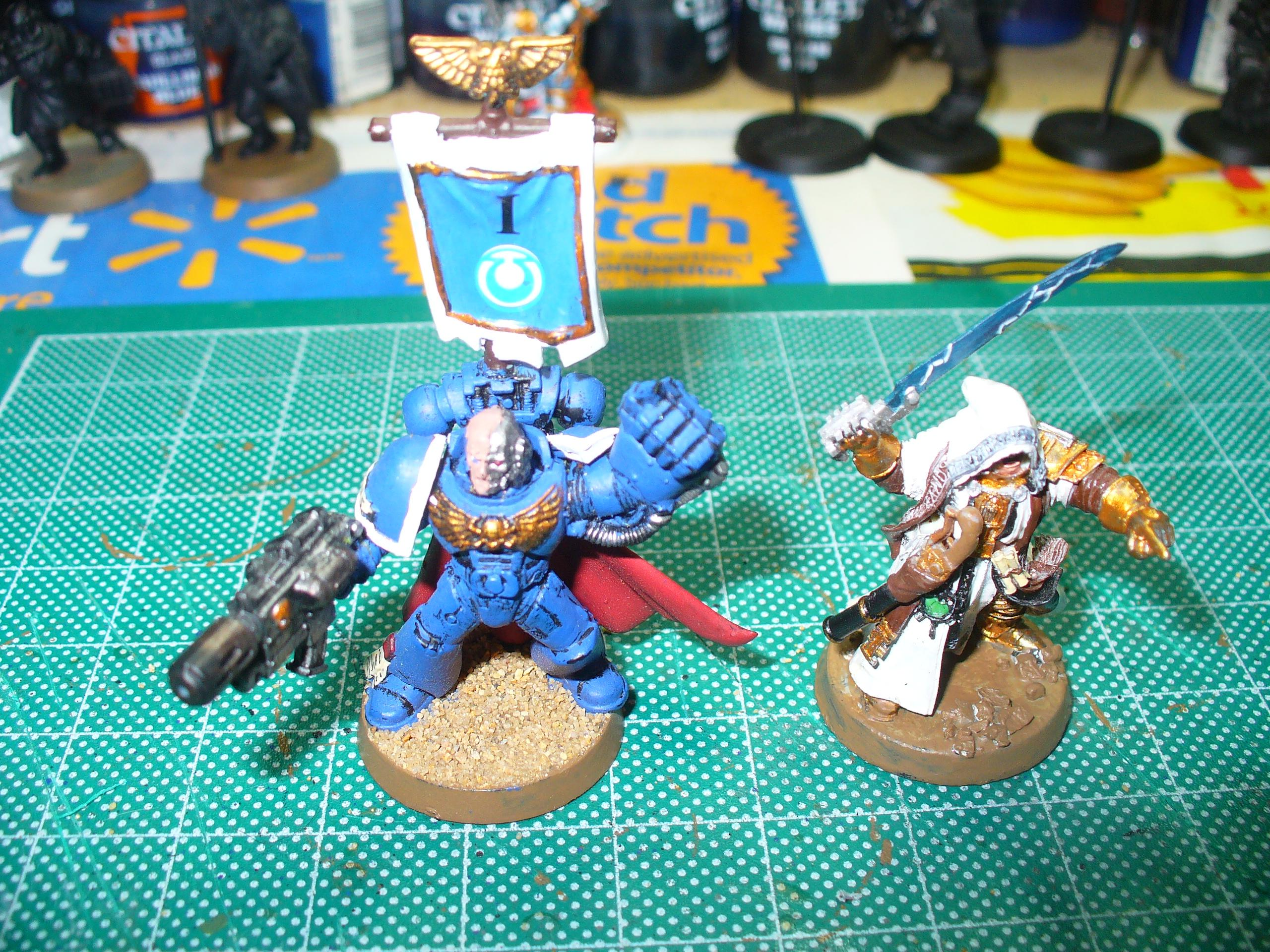 Here is the 1st Squad Sgt that was replaced in the last post with a regular one, this guy has been promoted to Sternguard, hence the change in the pauldron trim.  I also have an Inquisitor WIP, more on him later