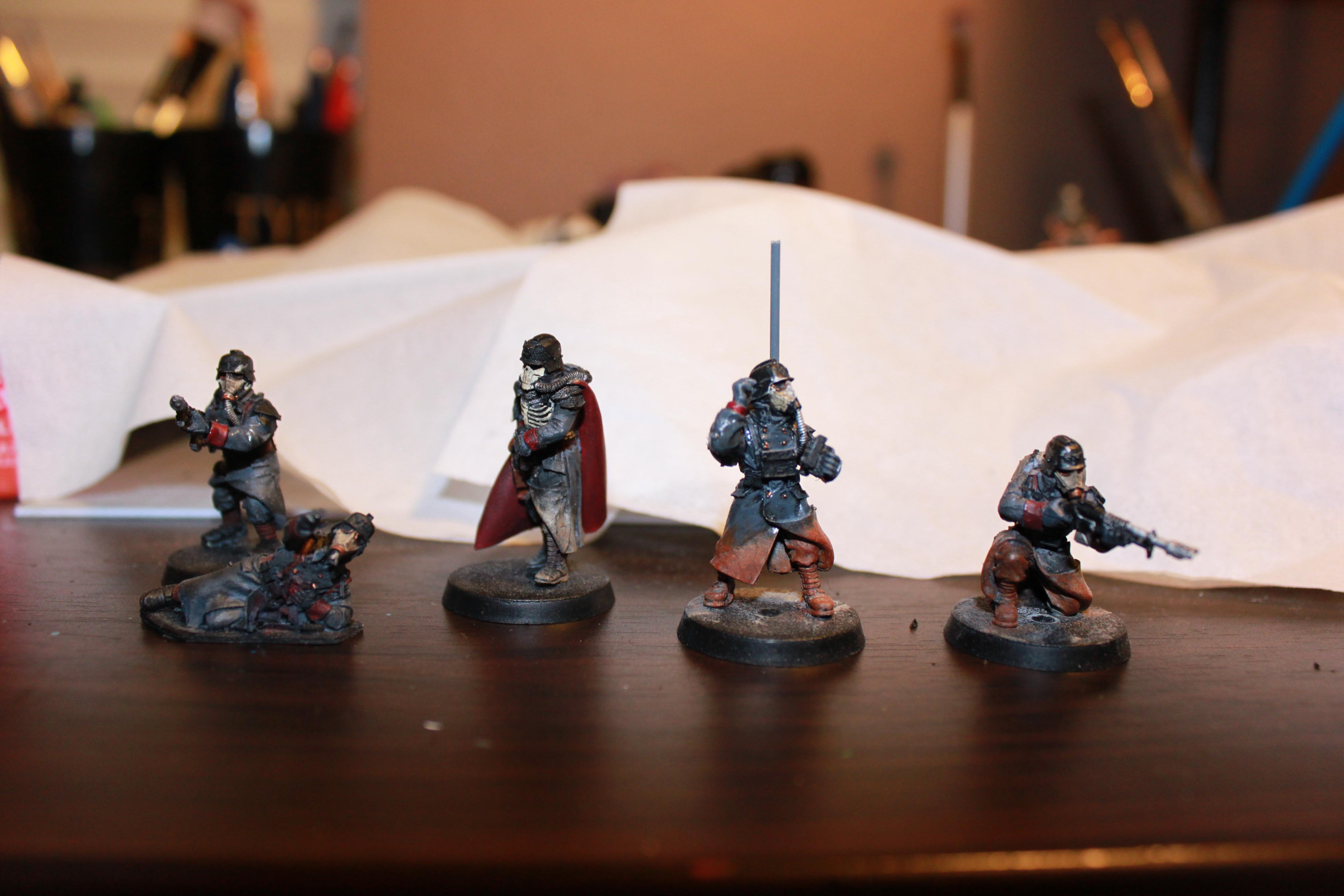 Quartermaster and vox caster + 2 guardsmen