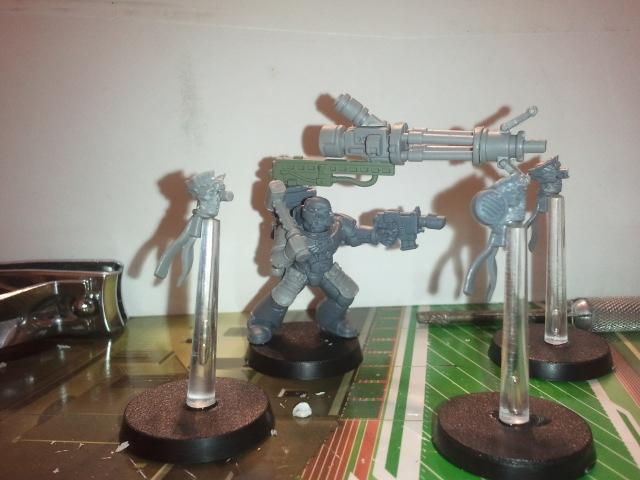 Kitbashed Ordo Xenos Inquisitor with Conversion Beamer and Servo Skulls. Don