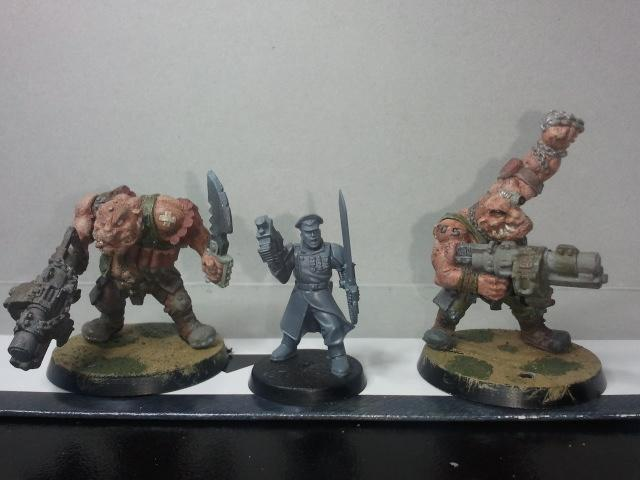 Two complete Ogryns with a Lieutenant for size comparison. They are a bit bigger than a Terminator, these old timey models