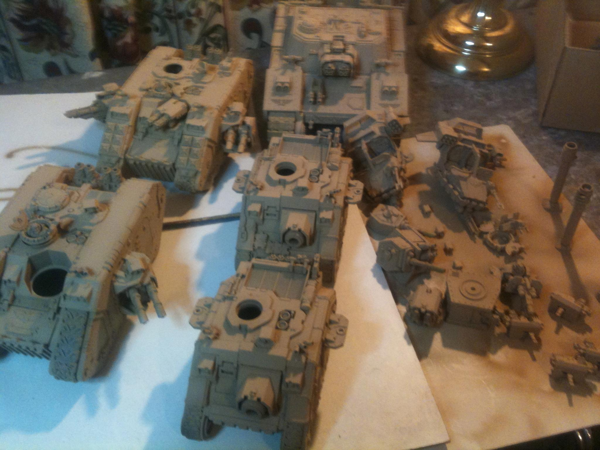 How they all look with 3 coats of progressively lighter Tamiya Desert Yellow. Camo stripes next