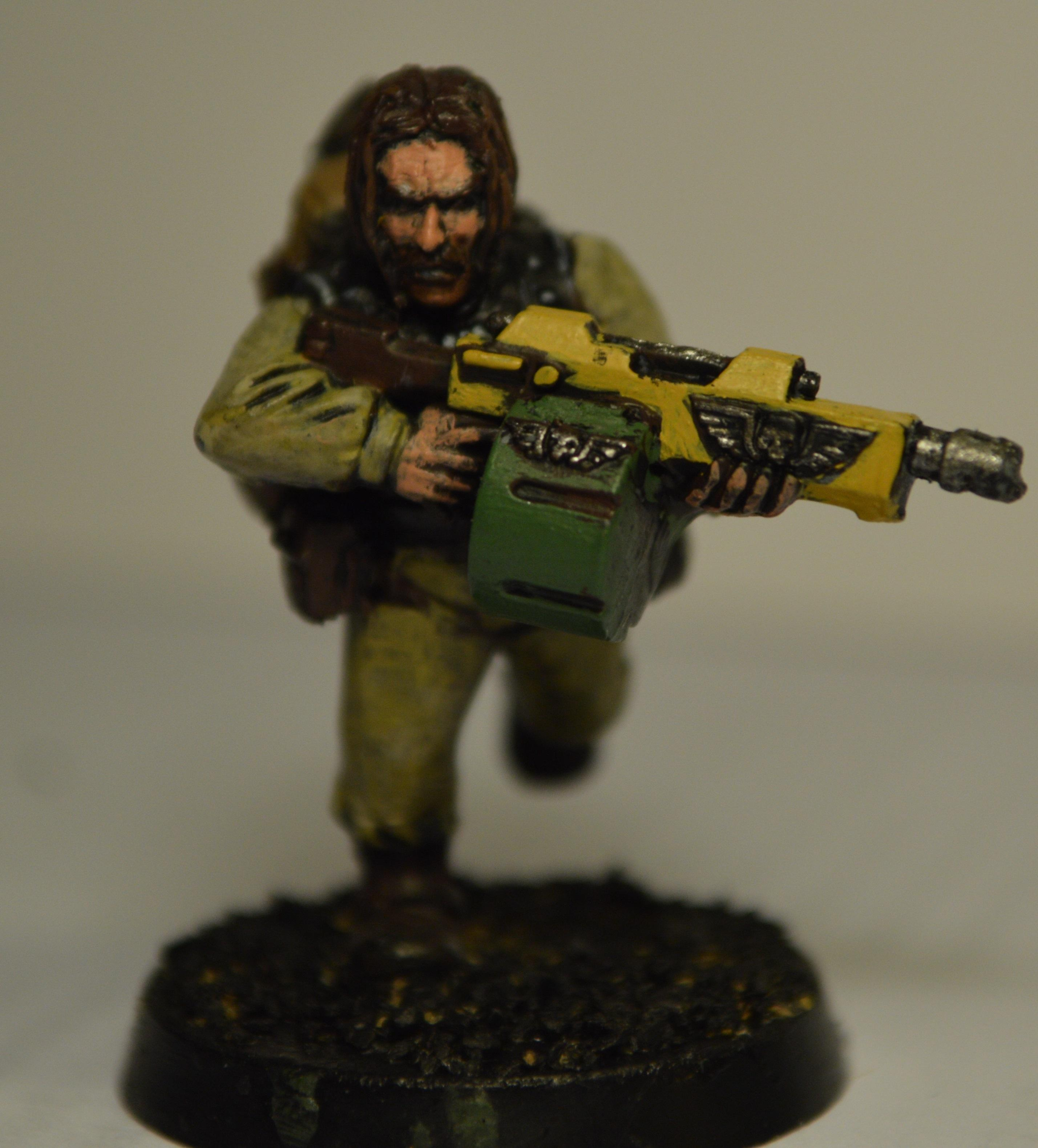 """Charlie """"Outlaw"""" Ronson.  Describes himself as being a """"procurement expert"""" before the invasion.  Quote: """"they say Orks don't feel pain or fear like we do.  I intend to test both of those theories"""""""