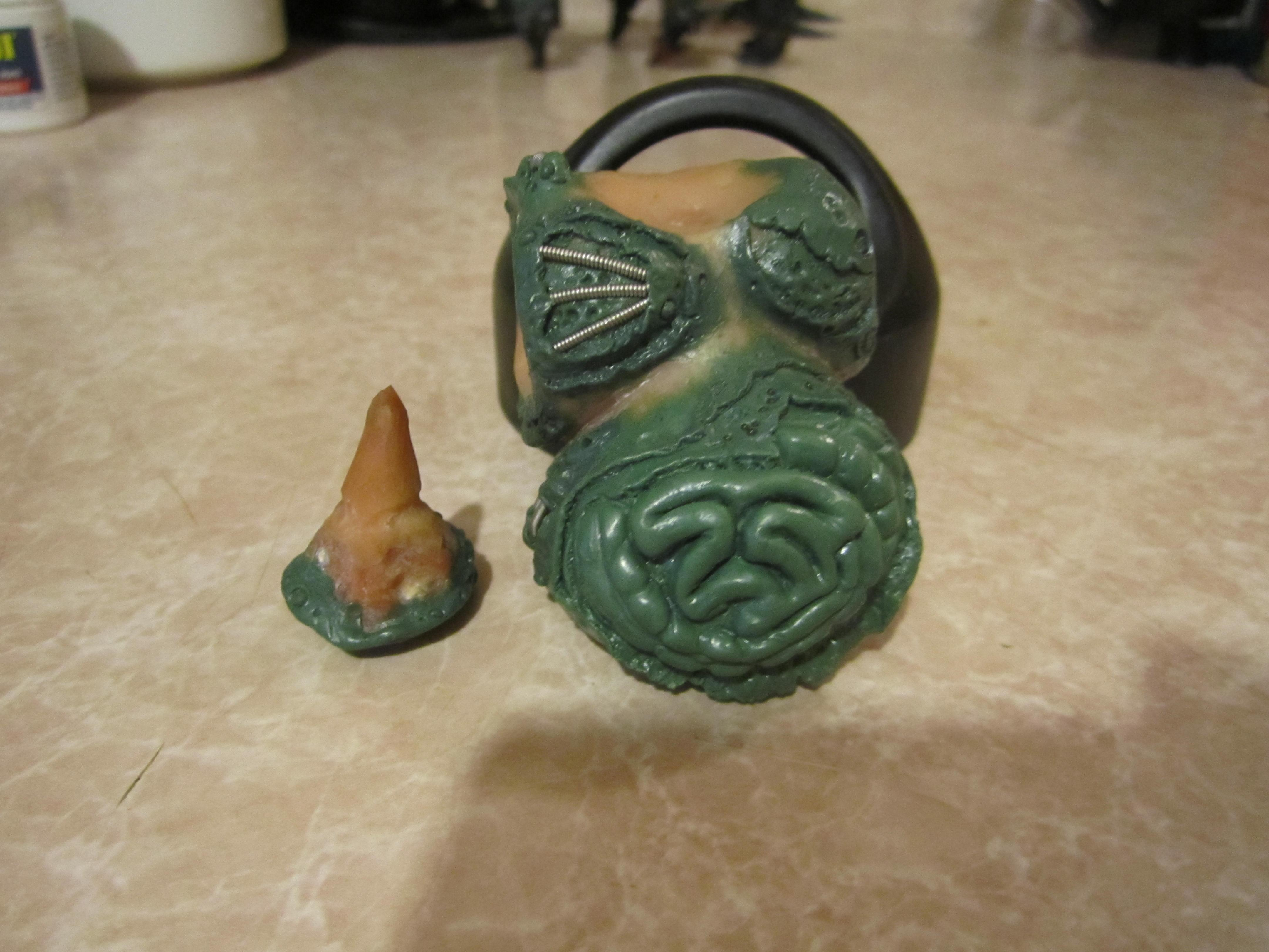 Shown with head removed.  Swappable heads
