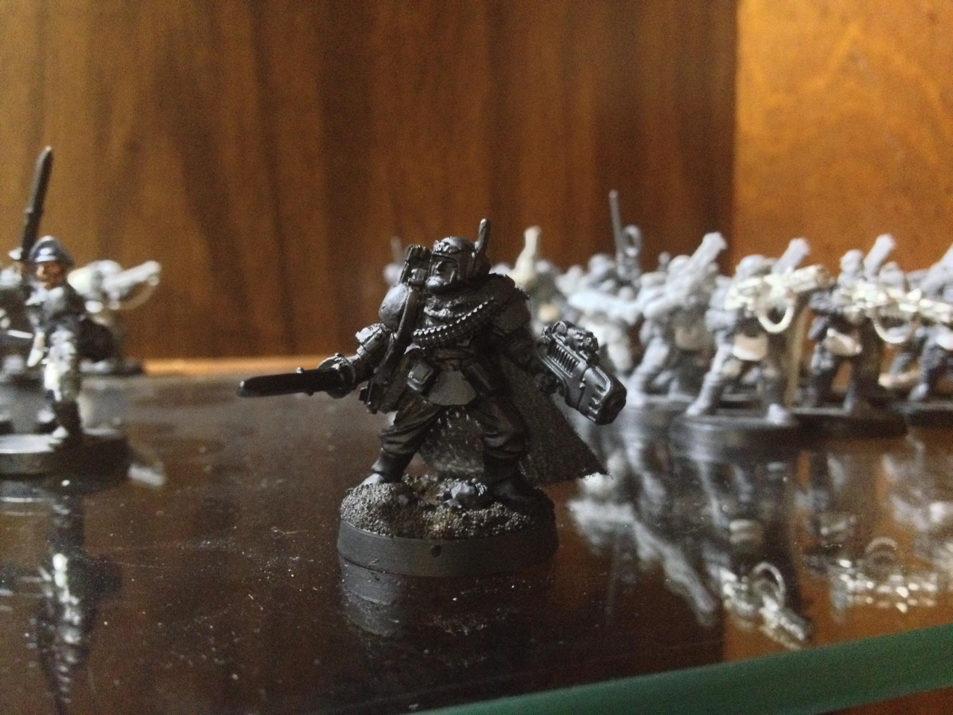 I also got around to basing and priming Colonel Roland