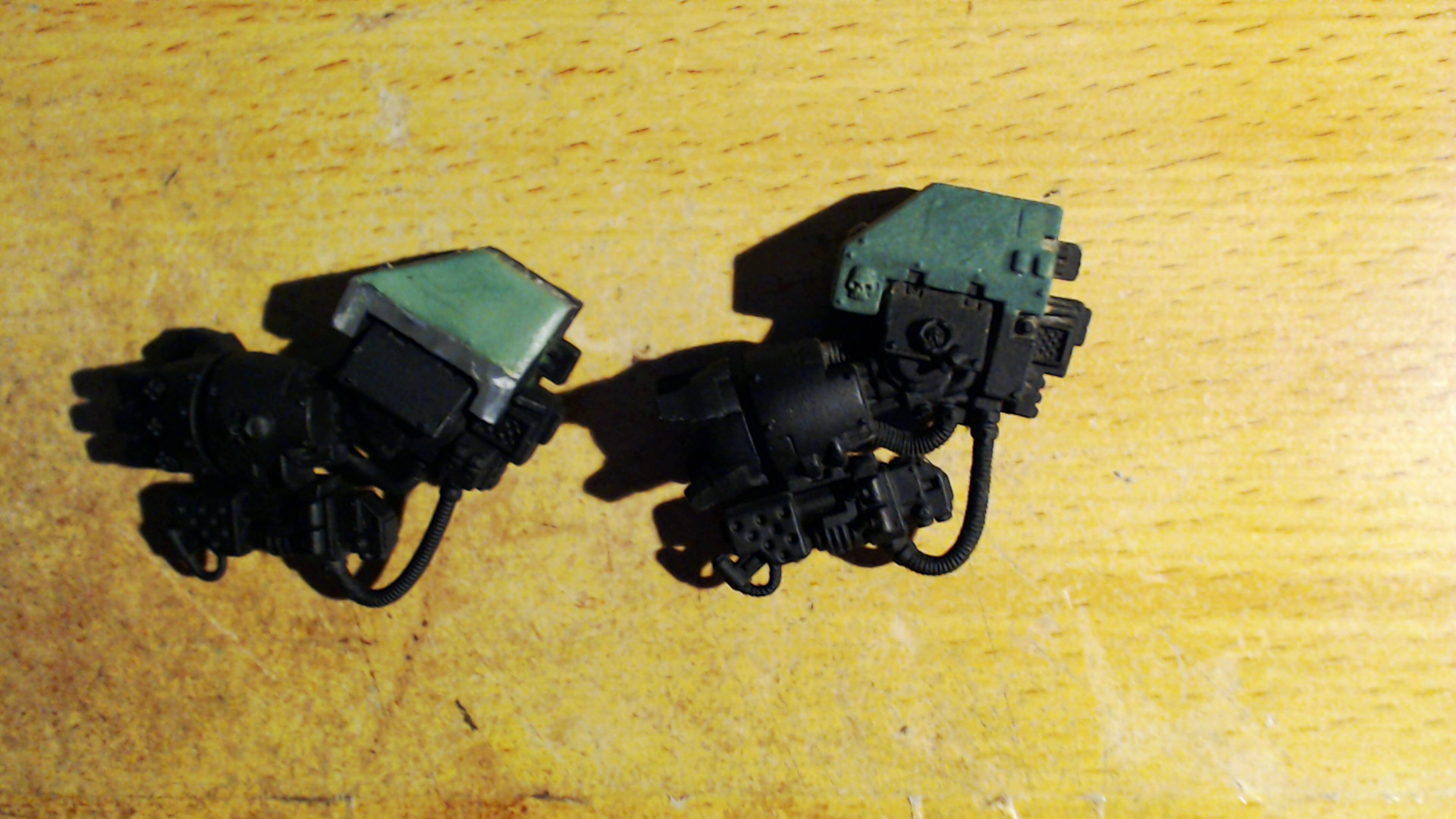Dreadnought Arms - Green Stuff Repair, Solid on Left Liquid on Right