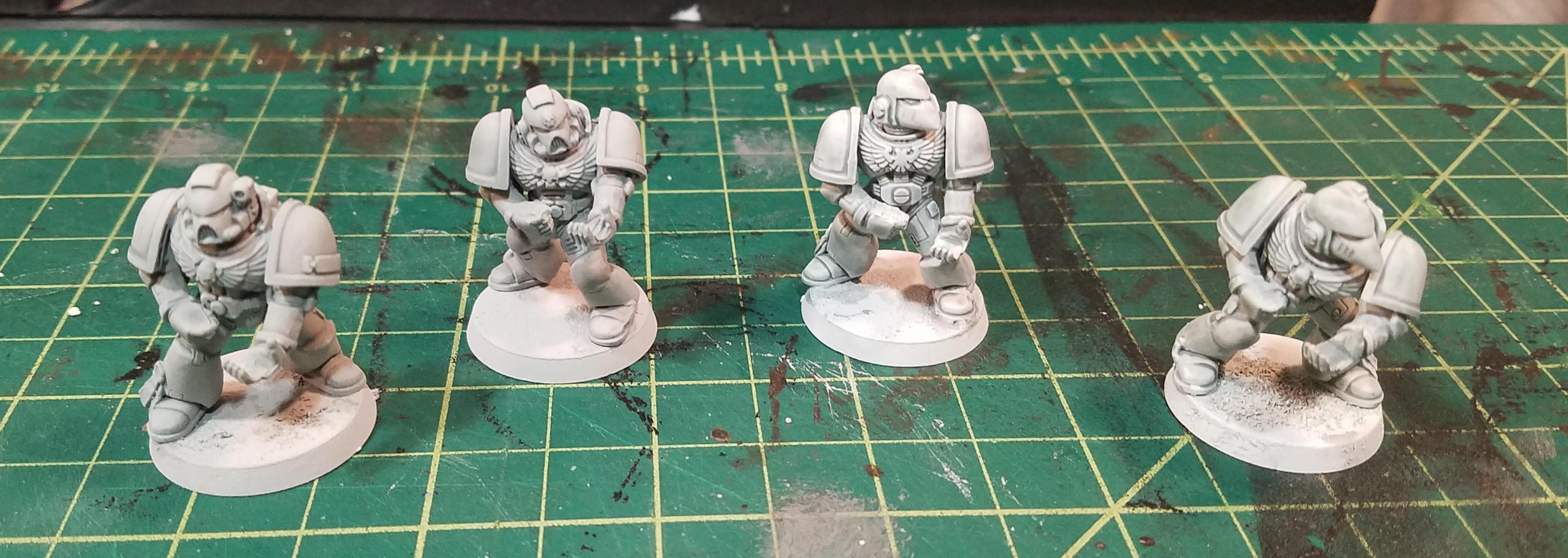 Corax White on the left, 2X Paint/Primer on the right, with a single coat of Apothecary White contrast paint